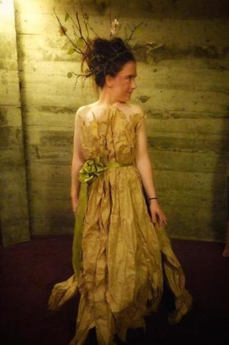 Wood Nymph — a mostly-compostable evening gown crafted from brown packing paper, and florist ribbon, crowned with a headdress of twigs and paper leaves